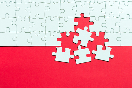 Red  made from white jigsaw puzzle pieces and place for your content