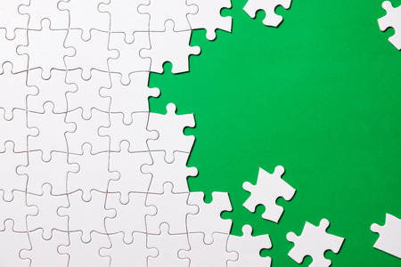 Green made from white jigsaw puzzle pieces and place for your content