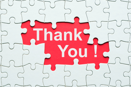 Thank you word on red  reveal under white jigsaw puzzle