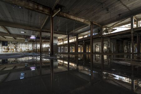 Interior view of abandoned factory warehouse in Detroit, Michigan