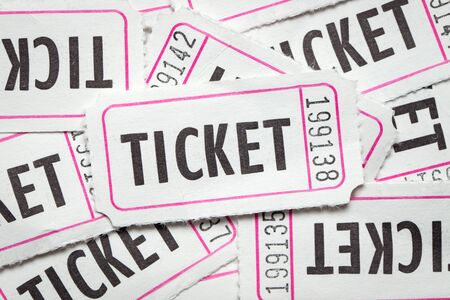 Multiple white color paper show tickets in pile Stock Photo