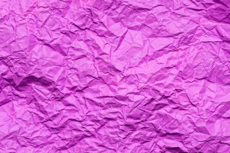 Pink crumpled paper  or texture in detail