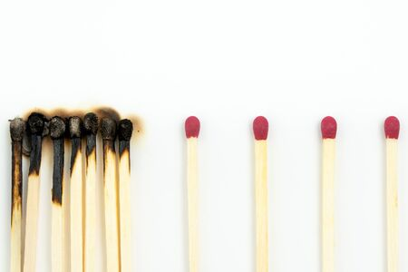 Social distancing concept using burnt out match sticks isolated on white Stock Photo