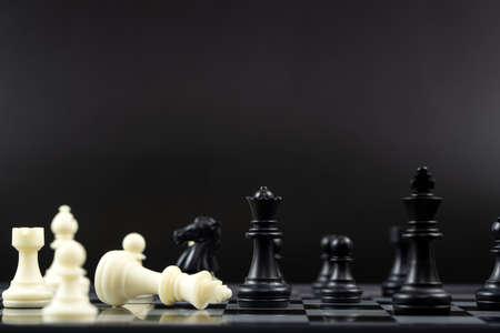 Black chess team win over white chess team for business winning concept