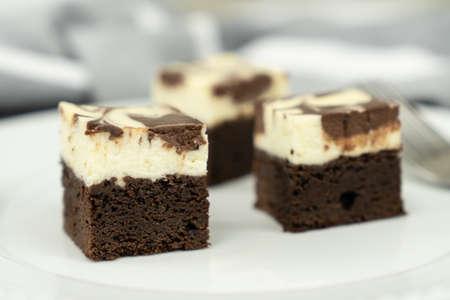 Cutting of homemade cheesecake swirl brownie or fudge