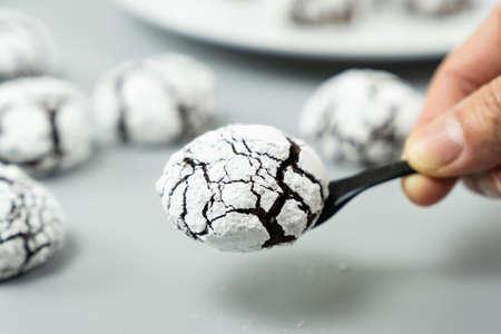 Chocolate crinkle brownie cookies in powdered icing sugar