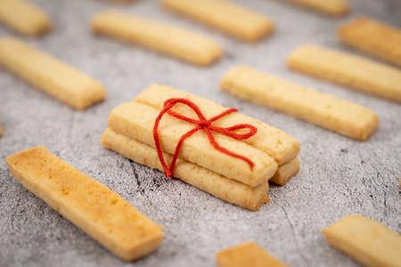Homemade parmesan cheese cookie sticks ready to serve 版權商用圖片