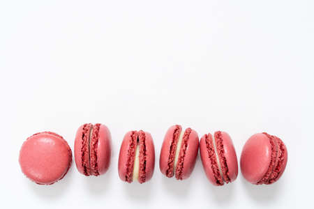 Traditional french red color macarons in a rows, strawberry favor 版權商用圖片