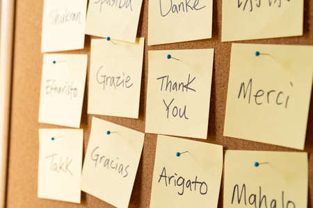 Thank you word cloud on yellow sticky note paper with different or multi languages