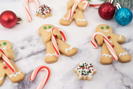 Christmas butter cookies ginger bread man hold candy cane and snowflake cookies