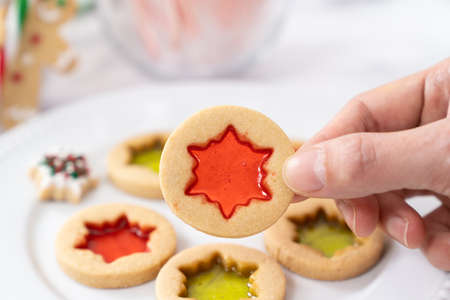 Christmas butter stained glass window cookies in hand