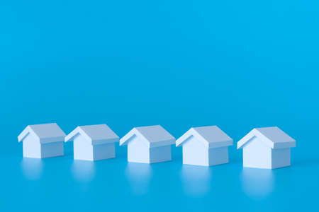 Real estate property concept using miniature white houses