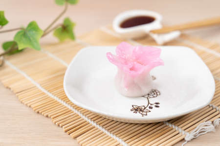 Chinese pink color flower dumpling or dim sum