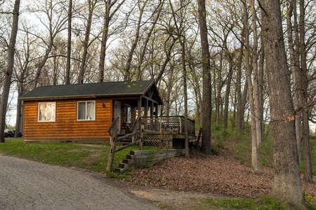Wooden hut cabin at rural fall landscape