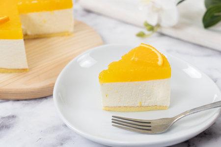 No baked orange cheese cake with fresh oranges decoration