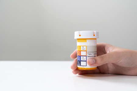 Orange pill bottle concept for healthcare and medicine 版權商用圖片