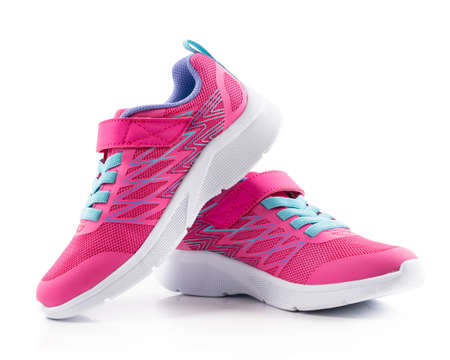 Pair of pink running shoes on white background