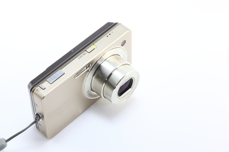 typical compact digital camera as a tool for the digital age.