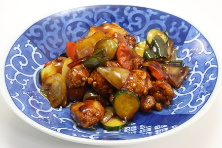 This is a picture of sweet and sour pork dinner which I ate in one day. photo