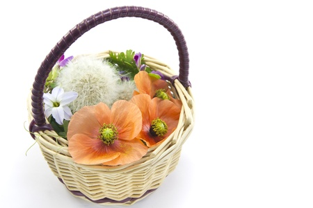 This is a flower basket made of wild grass  photo