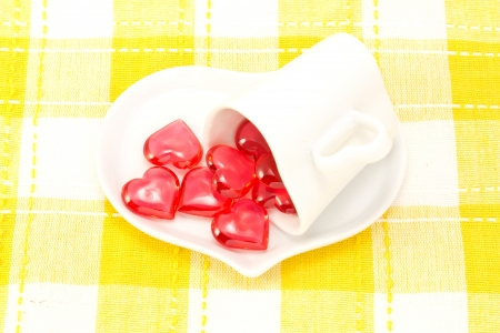 This is a picture of a red hearts and heart shaped cup on the table. Stock Photo - 14539068
