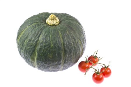 This is a picture of cherry tomatoes and pumpkin I have taken in August. Stock Photo