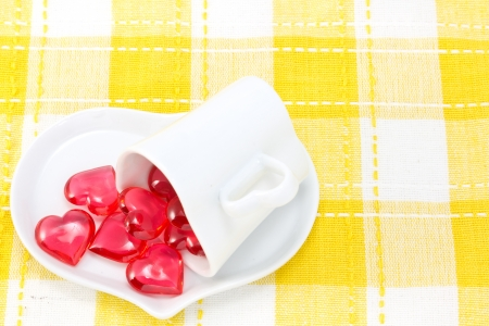 This is a picture of a red hearts and heart shaped cup on the table  Stock Photo