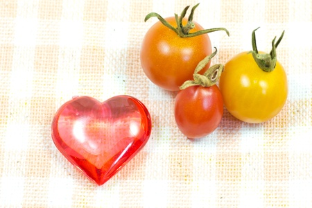 This is a picture of a red heart and cherry tomatoes that I grew.