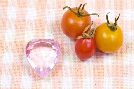 This is a picture of a pink heart and cherry tomatoes that I grew. Stock fotó