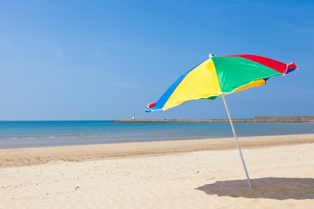 This is a picture of the sea and beach umbrellas of summer I was taken in summer  photo
