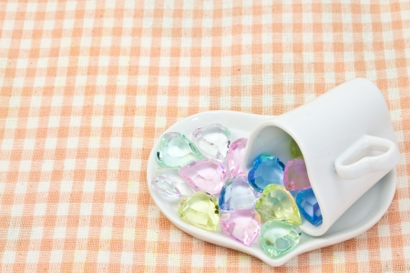 This is a picture of the colorful heart on a saucer   Stock Photo