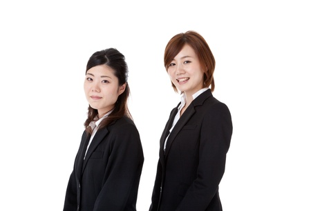 This is a photo of two young business people. photo