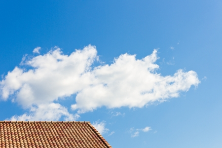 This is a photo of the roof and the sky I have taken on a sunny day. Stock Photo