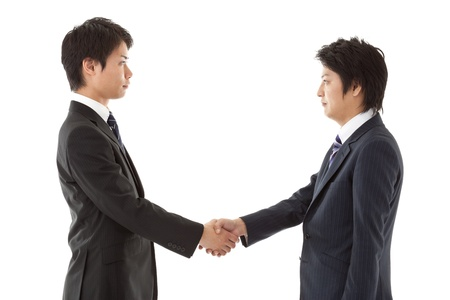 This is a picture of when you are seeking young businessmen handshake. photo