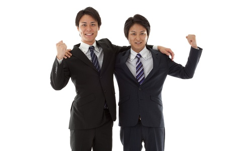 This is a picture of two young businessmen posing guts.