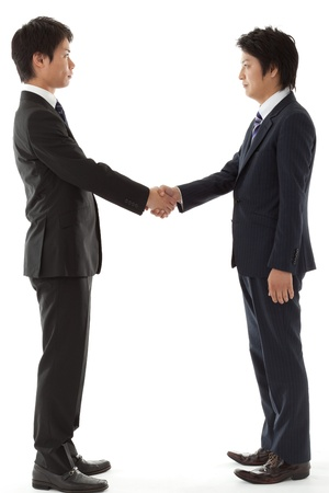 This is a picture of when you are seeking young businessman handshake. photo