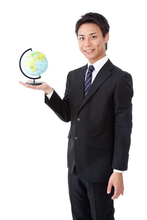 a young businessman with a globe. photo