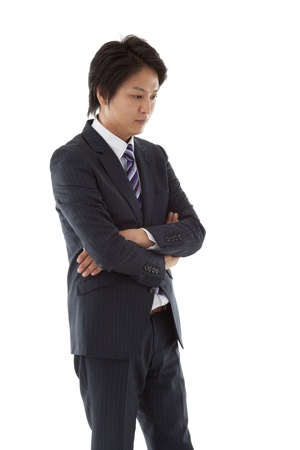 to fold one's arms: This is a picture of a young businessman thinking.