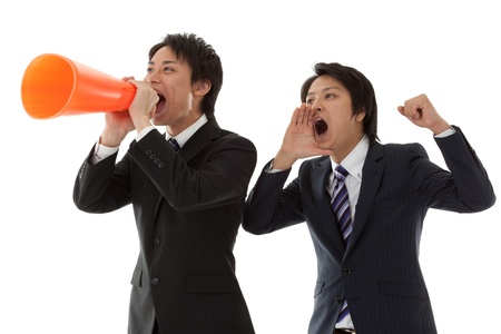 This is a photo of two young businessmen are cheering coworkers. photo