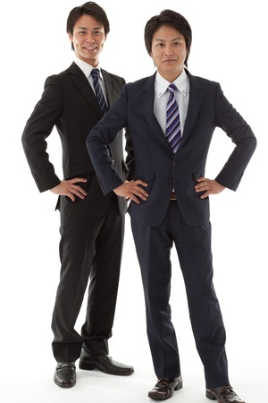 This is a photo of two young businessman. photo