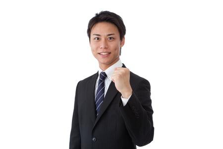 wnętrzności: Jest to obraz młodego biznesmena stwarzających odwagi