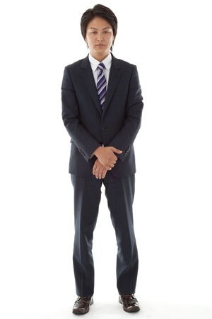 This is a picture of a young businessman is standing  photo