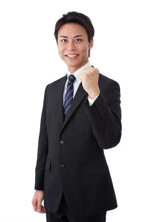 wnętrzności: Jest to obraz młodego biznesmena stwarzających odwagi.
