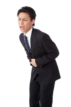This is a photograph of a young businessman suffering from abdominal pain.