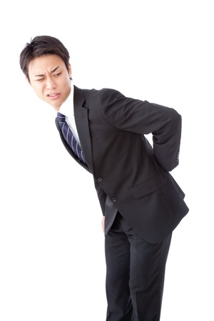 This is a photograph of a businessman suffering from low back pain. photo