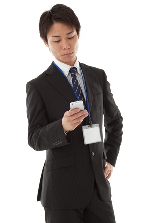 This is a photograph of a businessman working with smartphone. photo