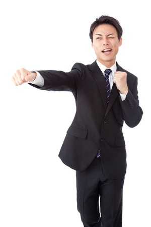 This is a photograph of a young businessman to hit the straight punch. Stock Photo - 16720771
