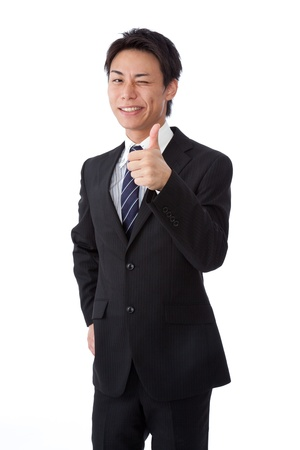 a young businessman with a wink and thumbs up.