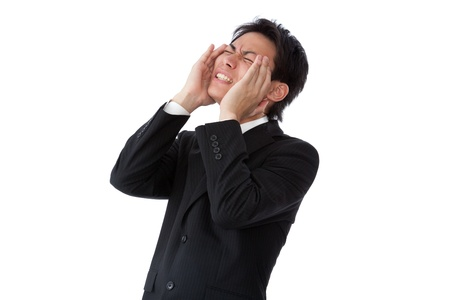 a businessman suffering from a headache  Stock Photo - 16753524