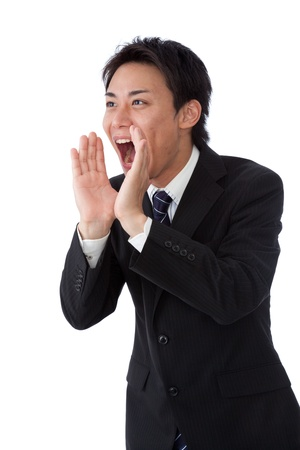 a businessman screaming loudly  photo